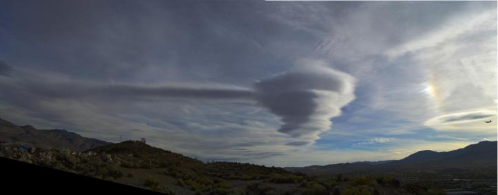 strange_lenticular_cloud_w_sun_dog___reno__nv_by_sketchkeysdigital_d83xu1h-fullview